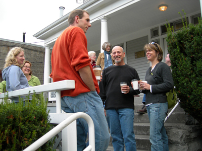 Trainees taking a caffeine break on the porch at MRC/WCC