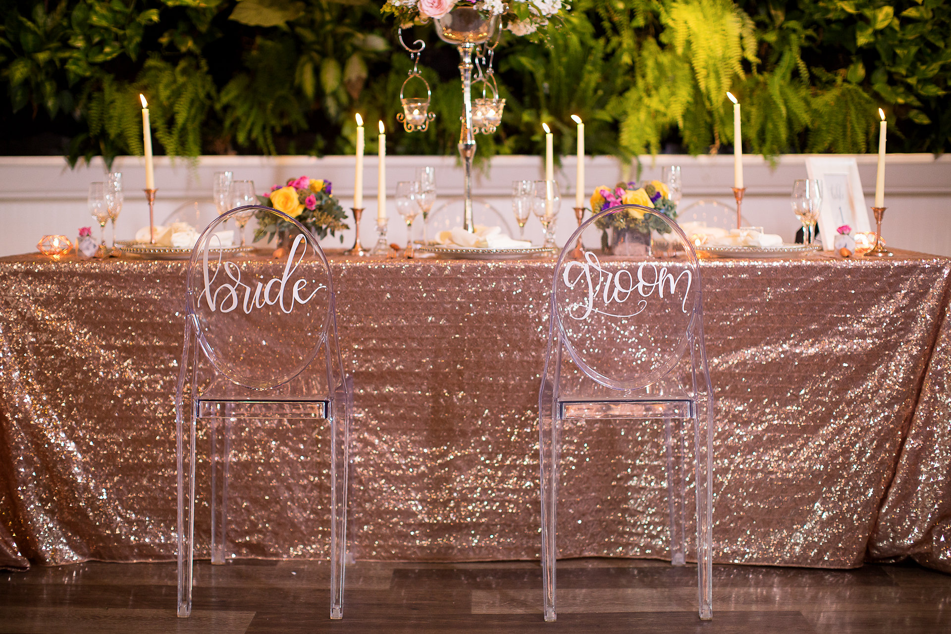 The incredible hand-lettered writing on the back of the chairs was done by Ink Letter Love!