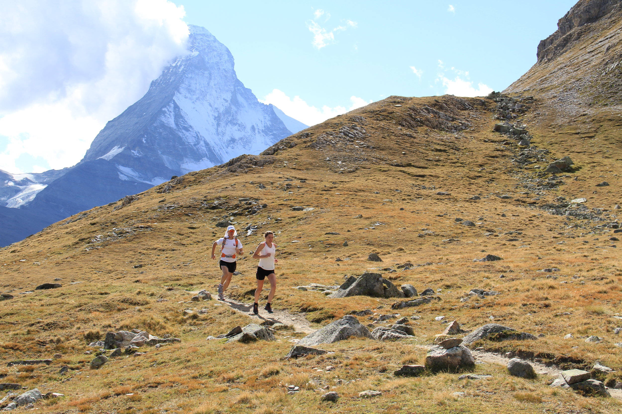 Emily and Matt trail running near the Matterhorn in Switzerland.