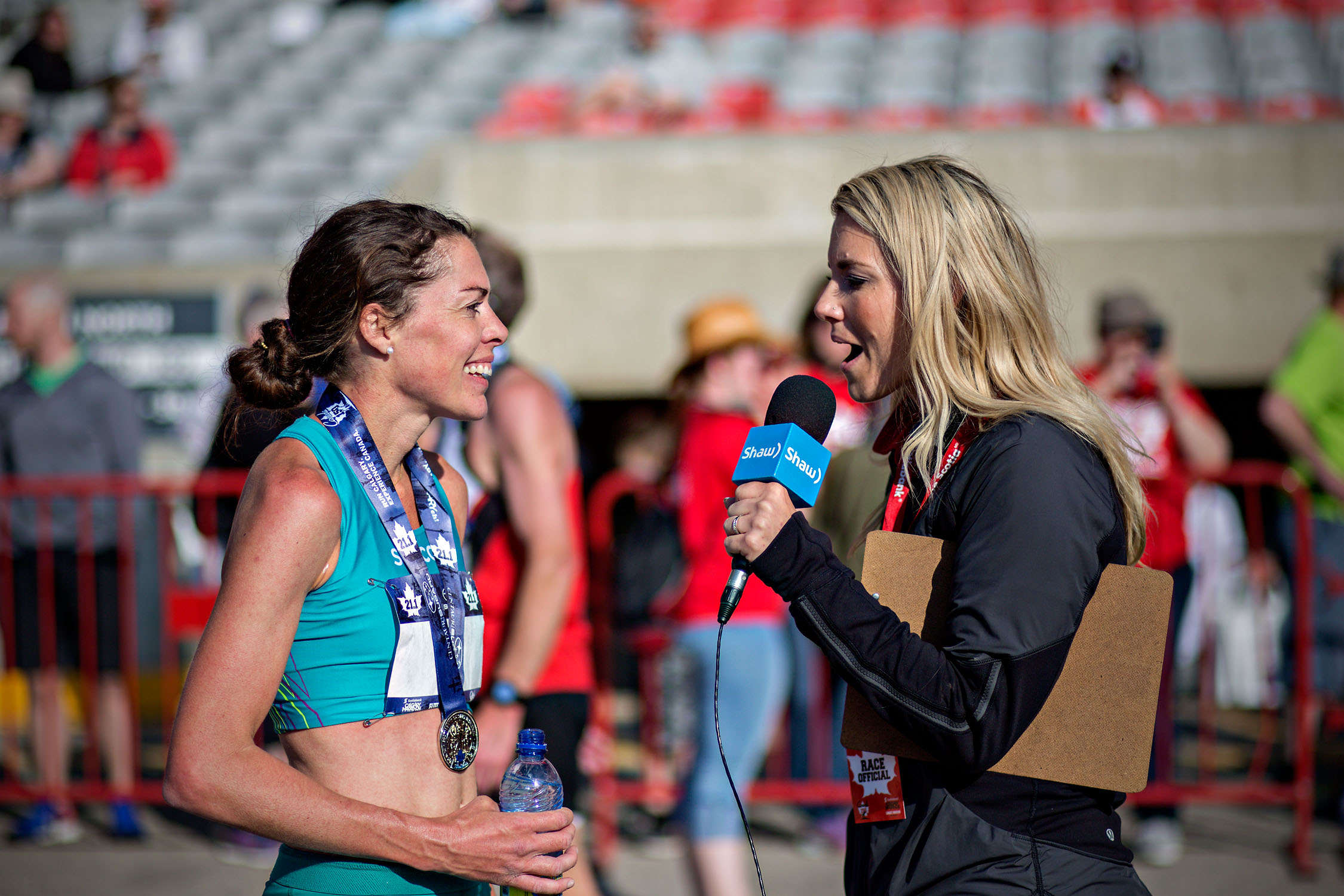 Emily talking to a Shaw Reporter after the 2017 Calgary Half Marathon (Canadian Half Marathon Championships).  Photo by: Jody Bailey (@run_photographs, jodybailey.ca)
