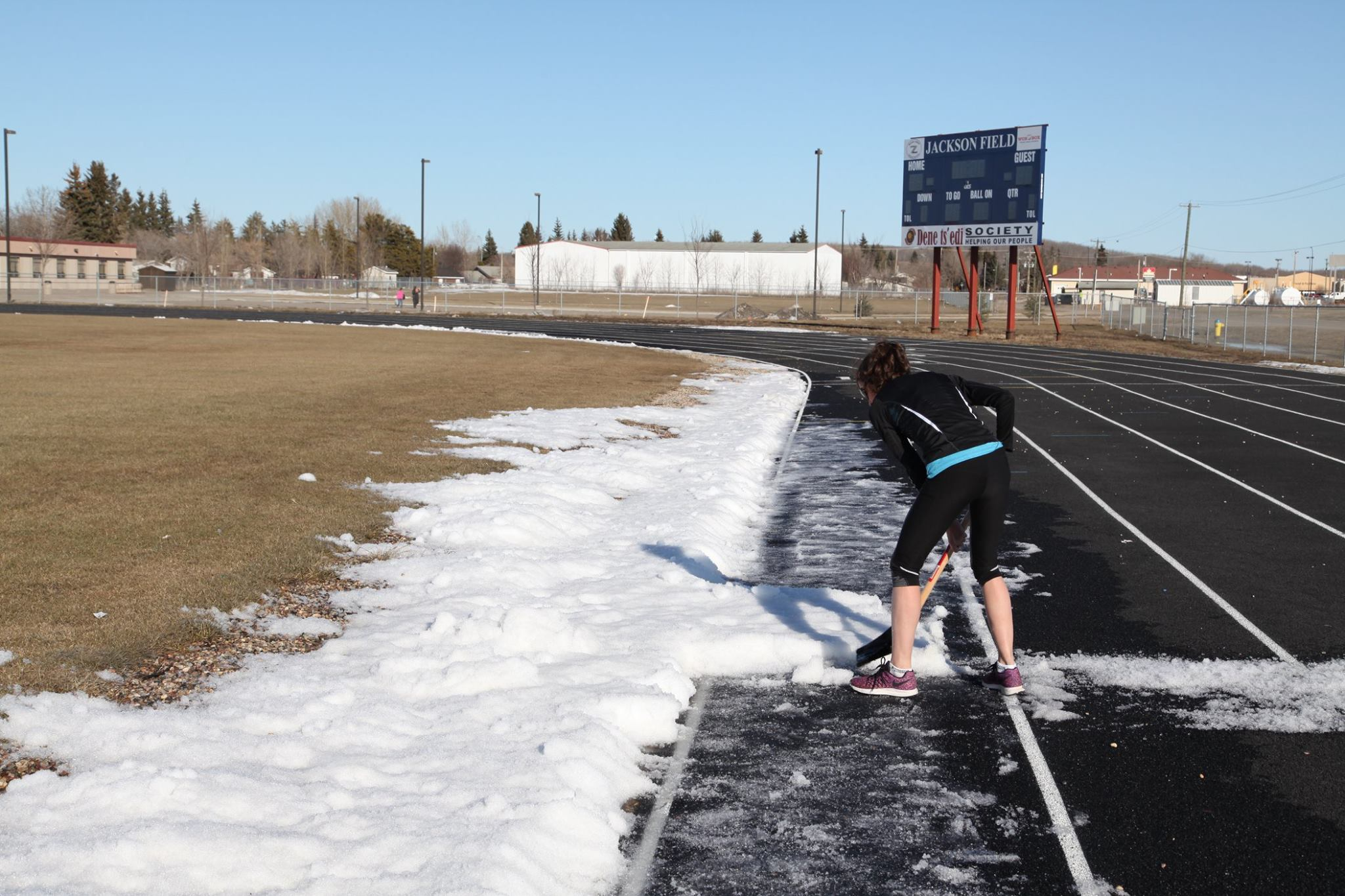 Shovelling snow off the track in the spring is also a way to warm-up.