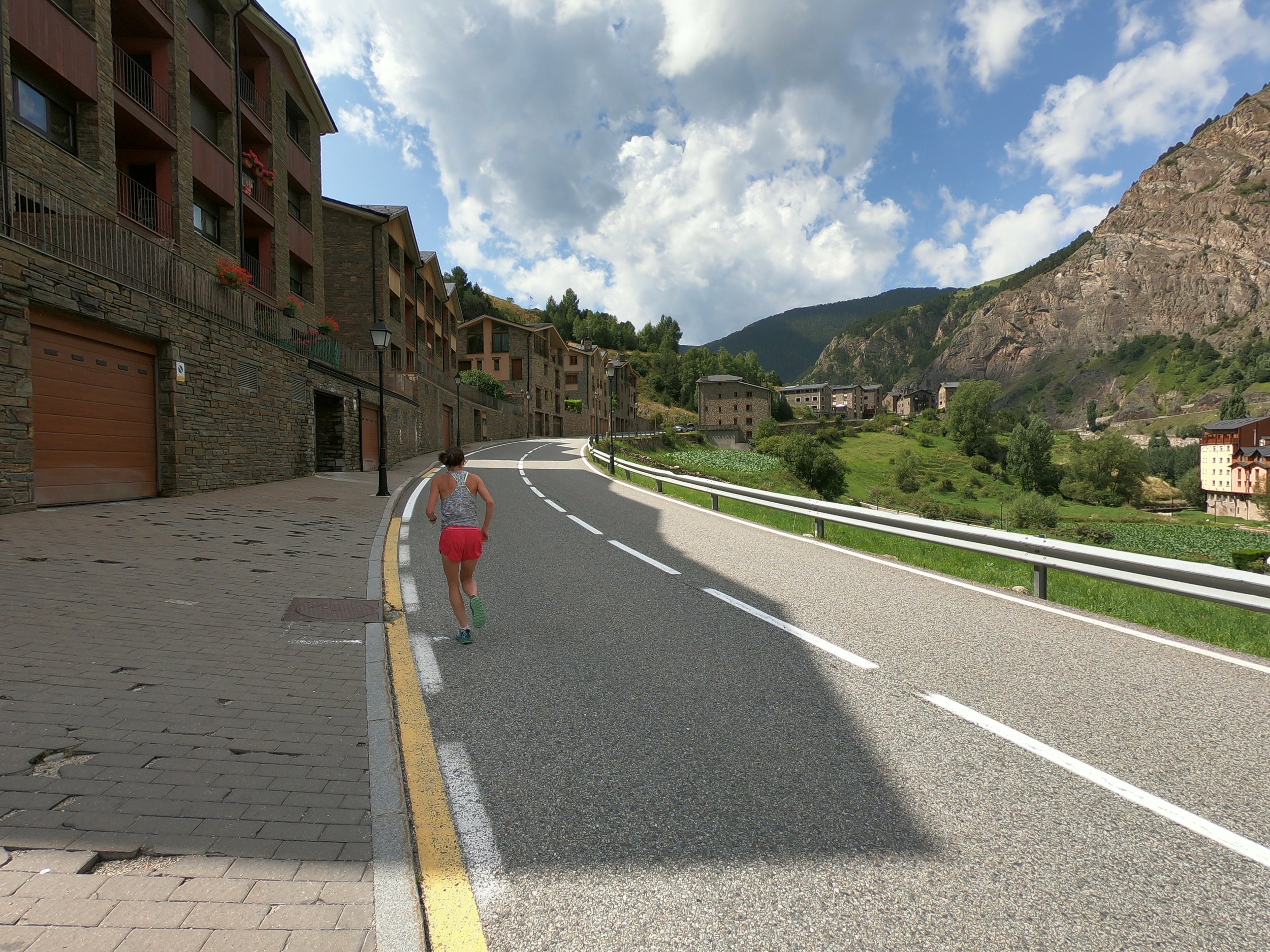 Emily (in pink shorts) running on the asphalt section. The first 1.3 km are a steady uphill (average gradient of 7%).