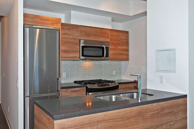1201 Dundas Street E Unit 501-small-012-5-KitchenBreakfast Bar-666x444-72dpi.jpg