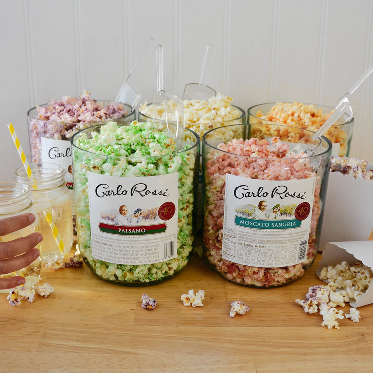 Tons of leftover Rossi jugs? Turn them into a rainbow of flavors with a DIY popcorn bar.
