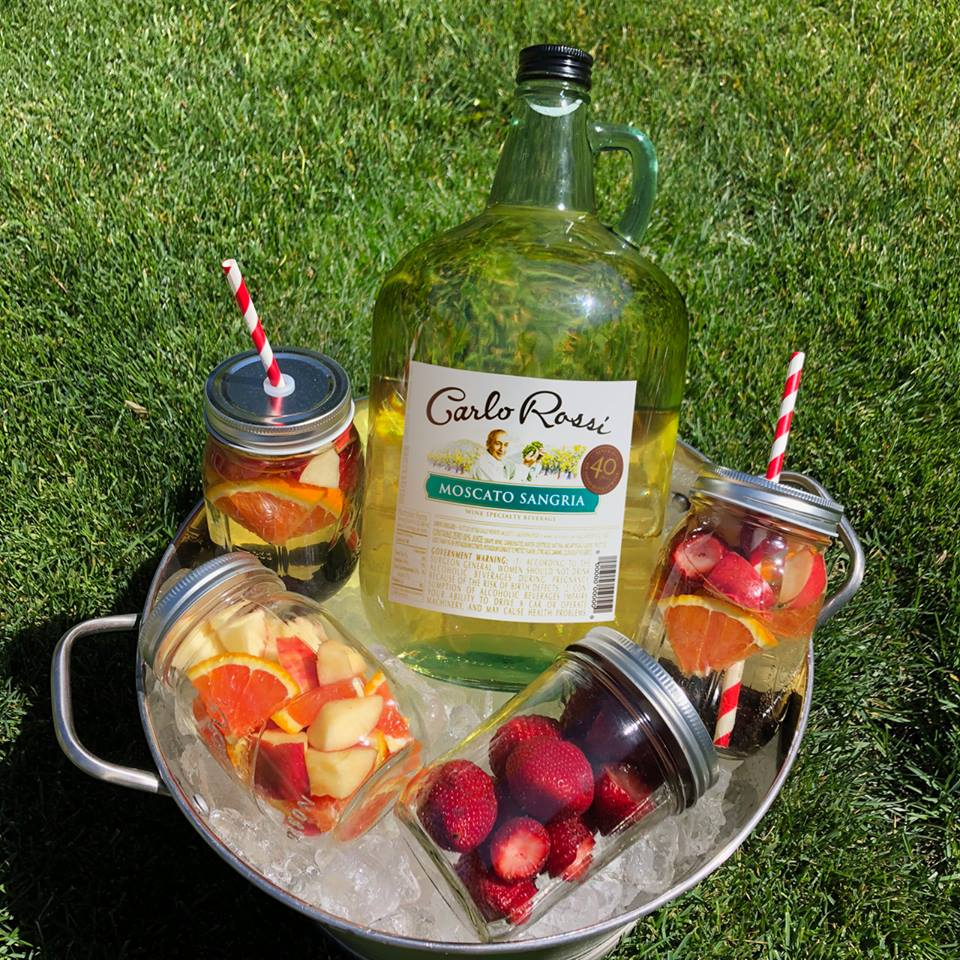 Hello people... we just solved summer. Prep for your backyard bbq by filling jars with fruit. Come party time, just pick one and pour in your favorite wine.    #boom       #SummerRecipe       #Sangria
