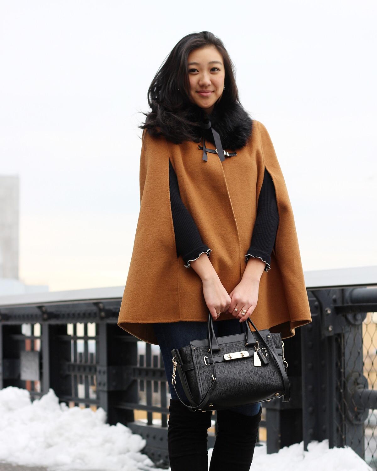 Cape: Zara but it's sold out so I've linked a similar  here  | Bag:  Coach  | Faux Fur Stole:  BCBGeneration | Boots:  Stuart Weitzman