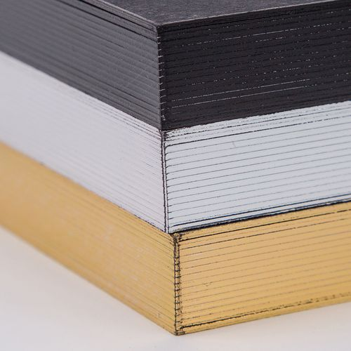 Gilding - $40Add black, gold, or silver gilding to your album. Not available for rounded corners, Metallic, or Classic Felt pages.