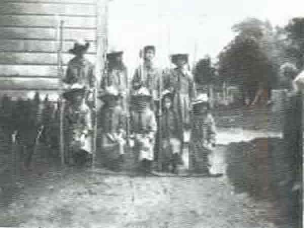 Oropi Scouts - Oropi Peace Scout Patrol, October 1923.Organised by the teacher Miss White, the patrol had home made khaki dresses and staves from the bush.