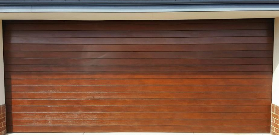 Before and after of a cedar garage door re-stained in a merbau tone.jpg