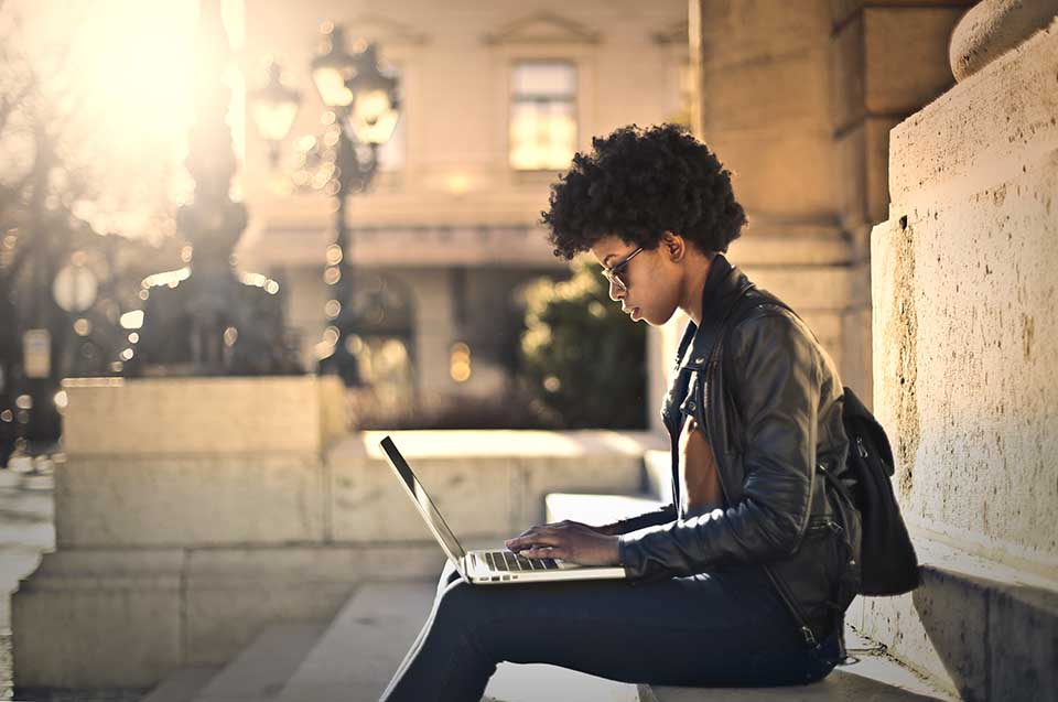 Woman with laptop on steps.jpg