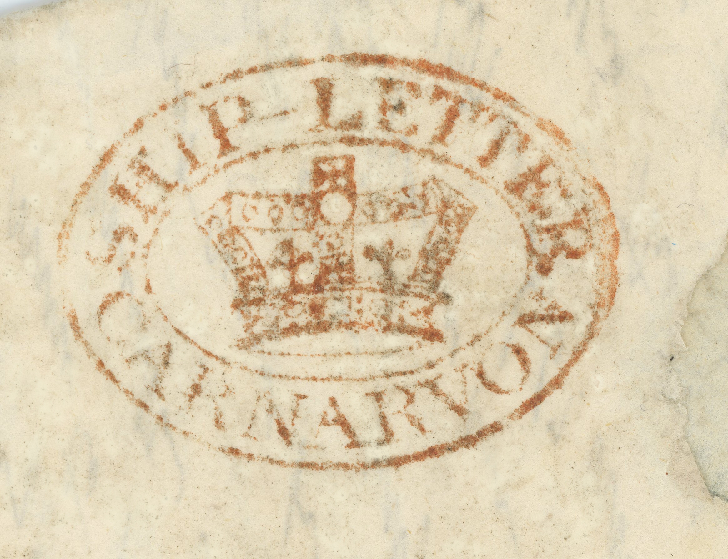 Carnarvon Ship-letter (crowned) - Robertson E.30/B S2.  Only two examples have been recorded, from the same provenance - letters from St John, New Brunswick- by private ship to Pwllheli. The 1823 letter to London recorded by Robertson carries a very indistinct mark in which only the . . . ON of CARNARVON can be distinguished.  The 1824 letter to Edinburgh which bears the above mark, also carries a PULHELY straight-line stamp.