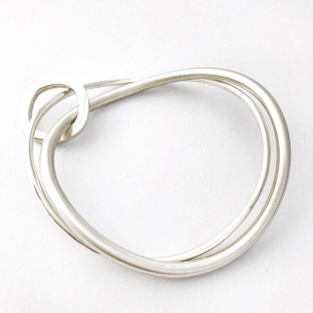 Sterling Silver Double Round Bangle with Square Reversible Ring. $260