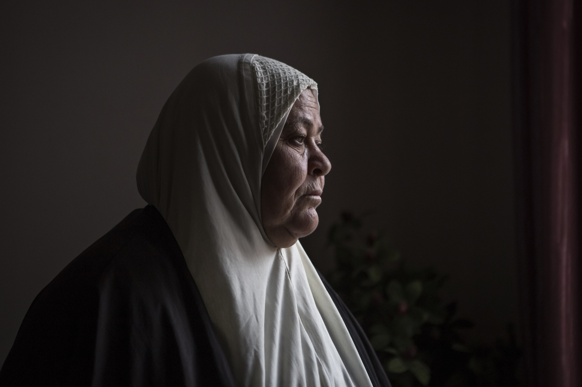 Umm Riyad lost her son when a mortar shell struck the roof of their house in east Mosul.