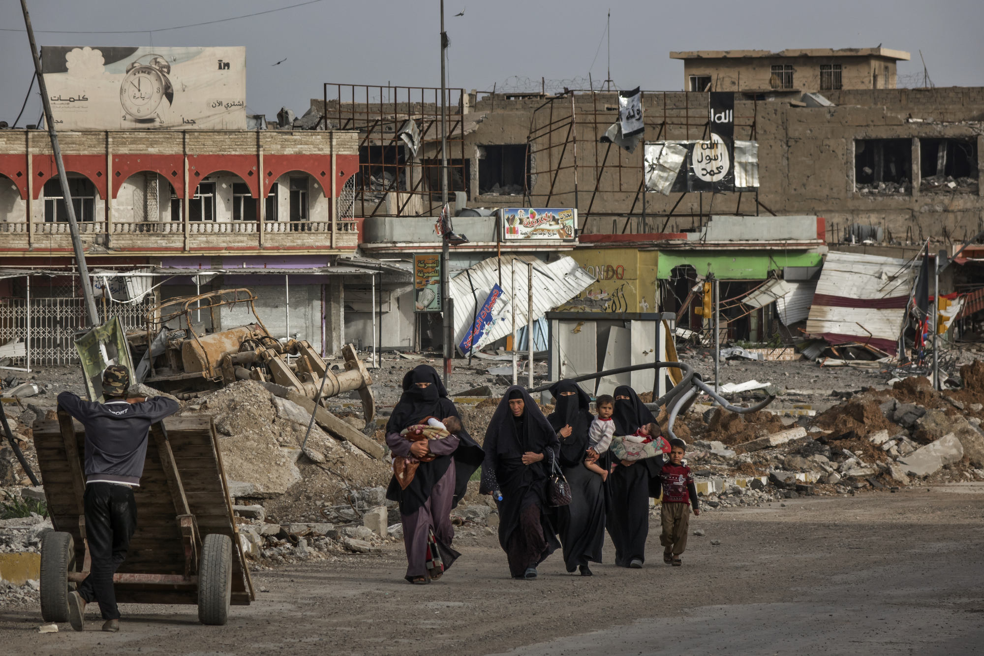 Civilians flee Mosul during the later stages of the battle.