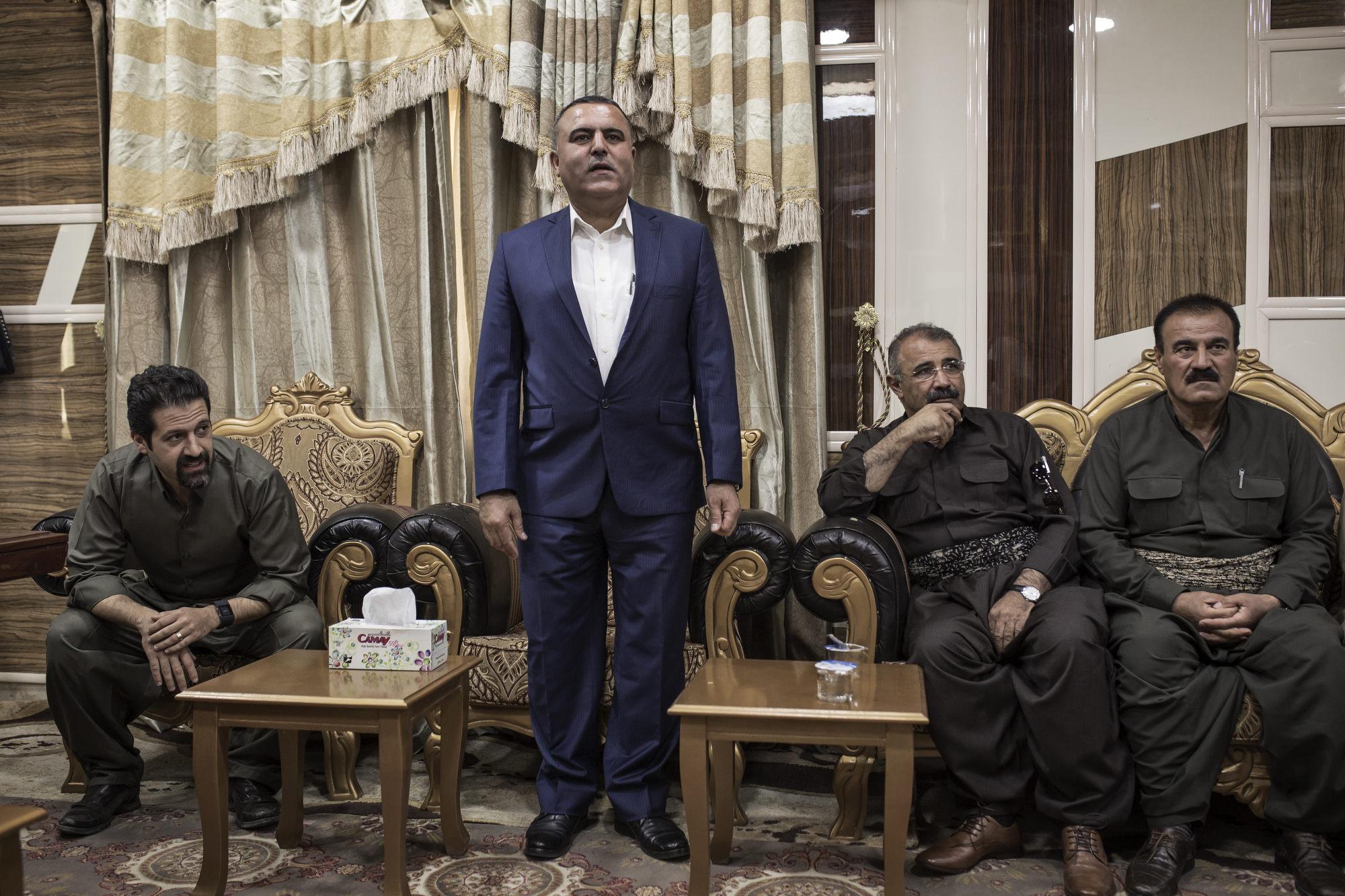 Shallal Abdul (standing), the Kurdish mayor of Tuz Khurmatu.