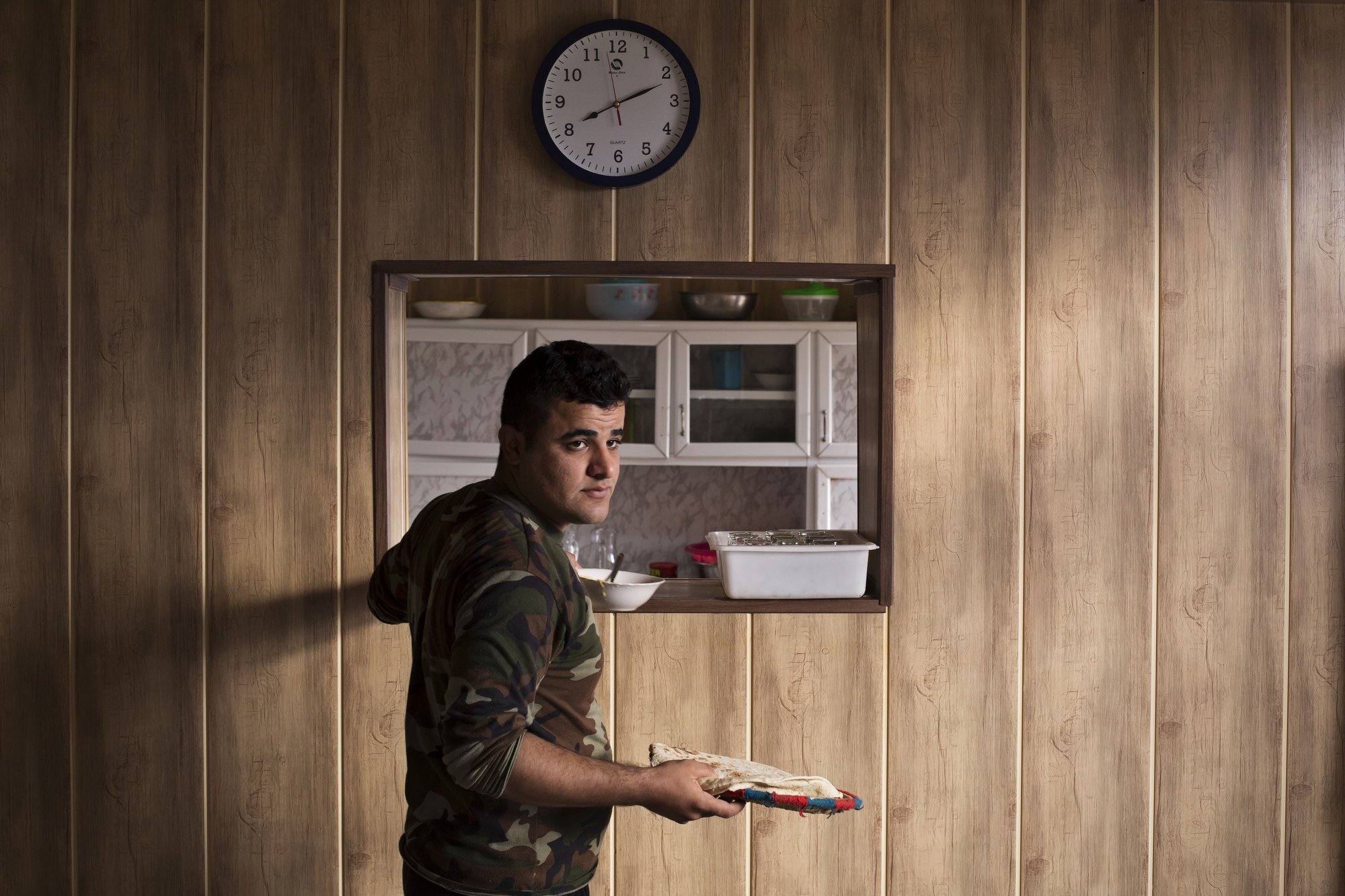 A cook prepares breakfast for officers at a base.