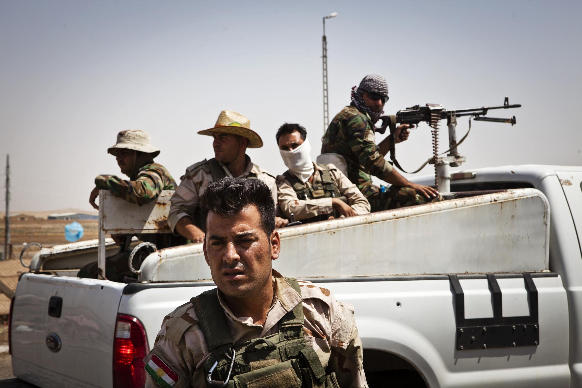 Peshmerga prepare to go on patrol.