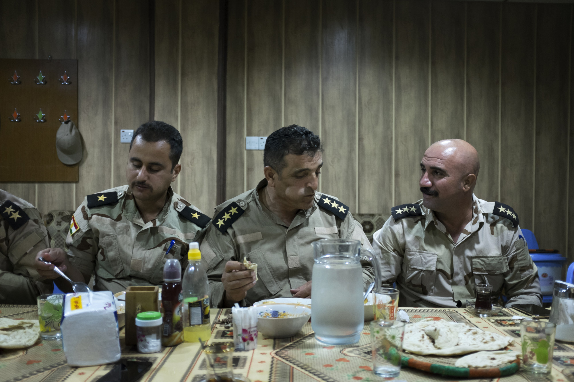 Officers eat an evening meal.