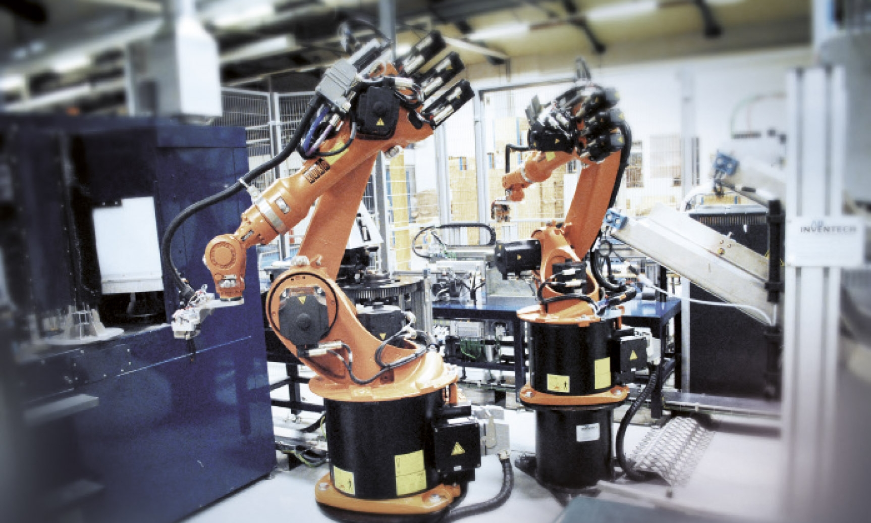ROBOT SYSTEM  A fully-automated robot system for the line production of steel clamp rings.
