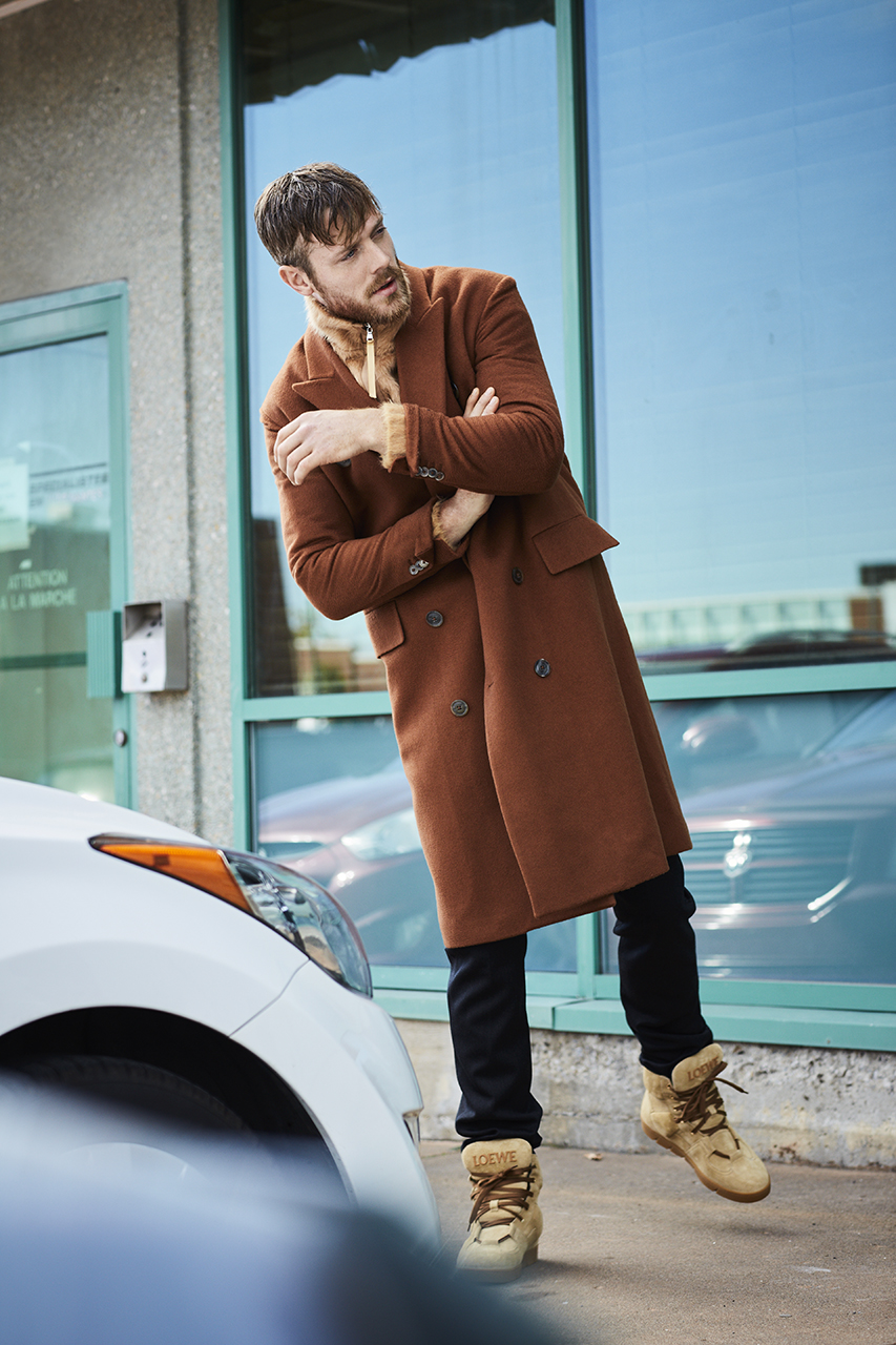 Coat  PAUL SMITH  $3,000. Sweater  LOU DALTON  $750 at SIMONS. Pants  LOUIS VUITTON  $1,060. Shoes  LOEWE  $1,190 at HOLT RENFREW.