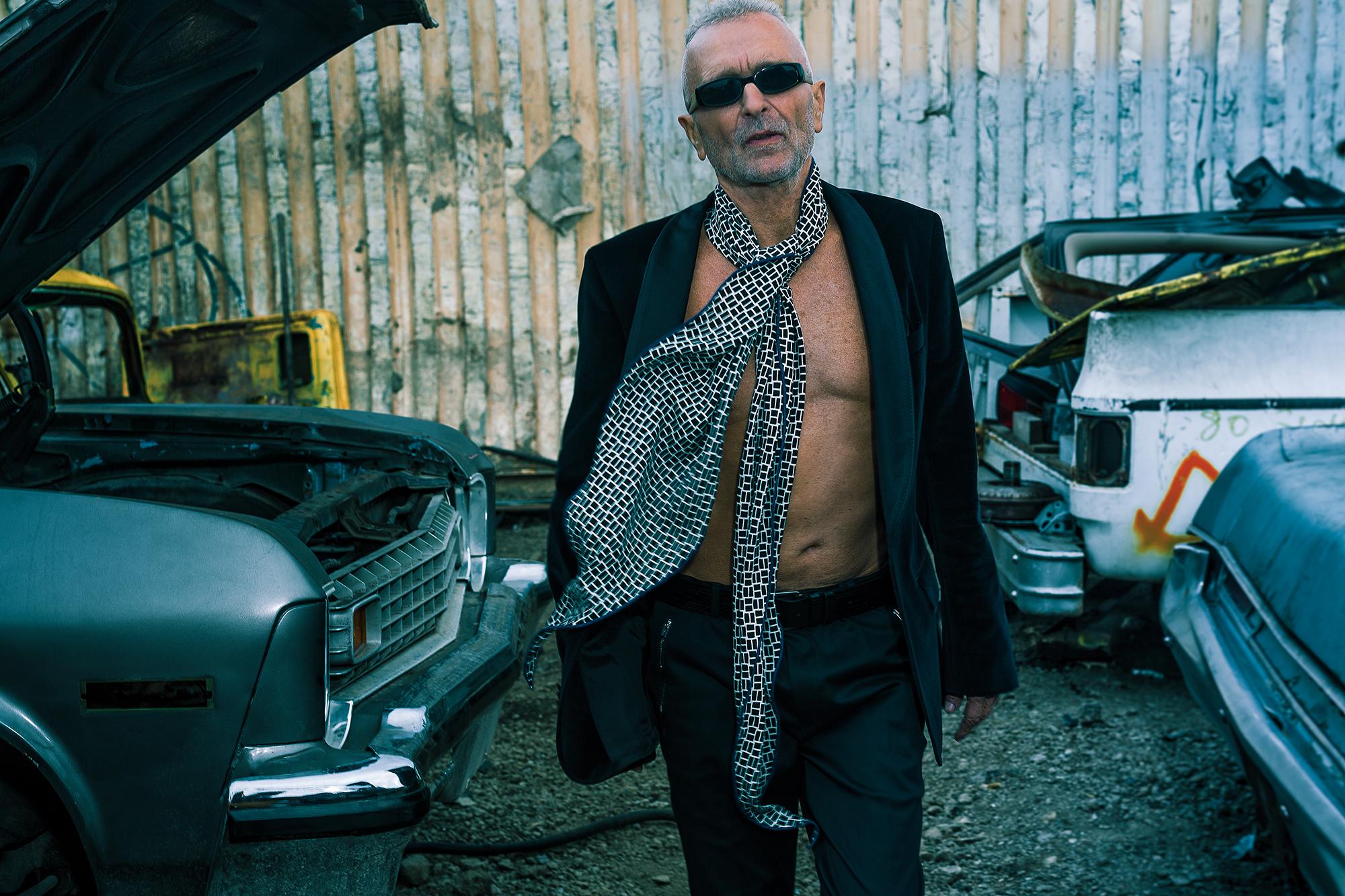 Sunglasses MONTY'S OWN. Scarf HERMÈS. Suit HUGO BOSS. Belt JIMMY CHOO.