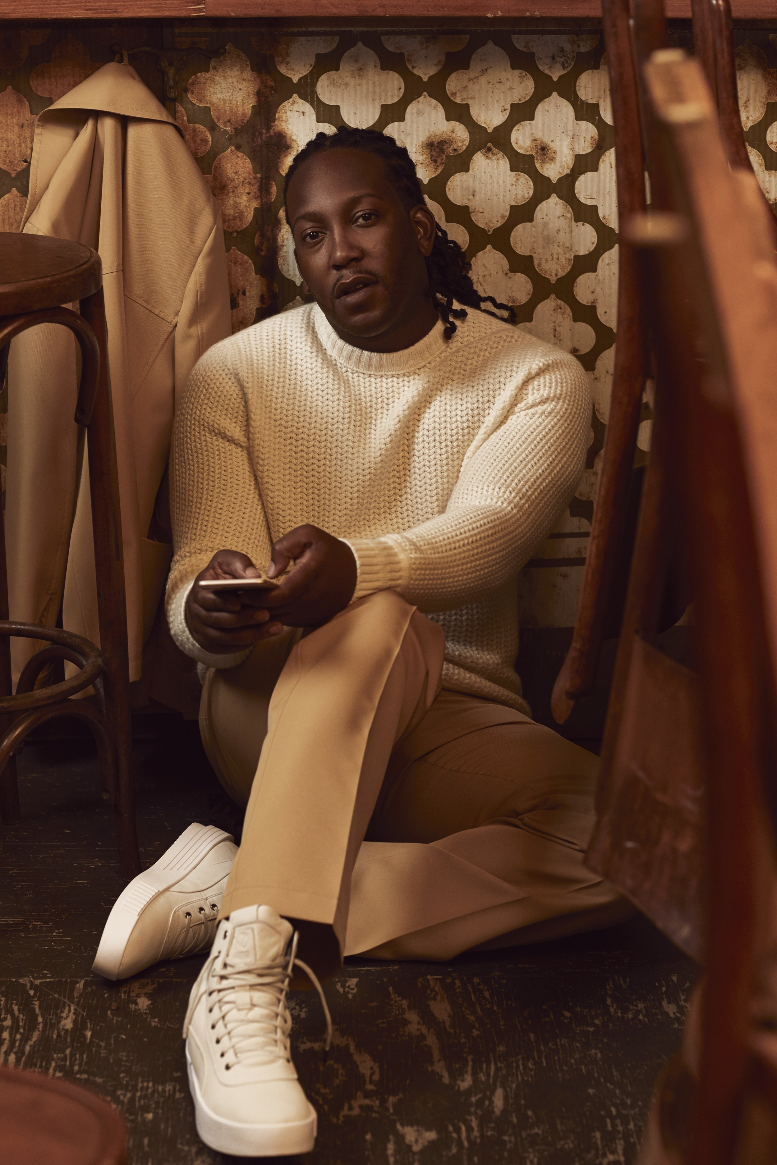 Pants and jacket MARNI at HOLT RENFREW. Sweater BERLUTI at HOLT RENFREW. Shoes THE WEEKEND X PUMA XO COLLECTION.