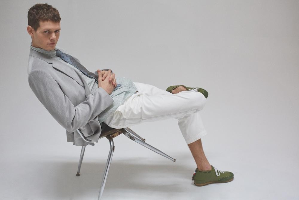 Blazer, shirt, & tie BILLY REID. Pants ($120) TOPMAN. Sneakers ($395) HEIRLOOM.