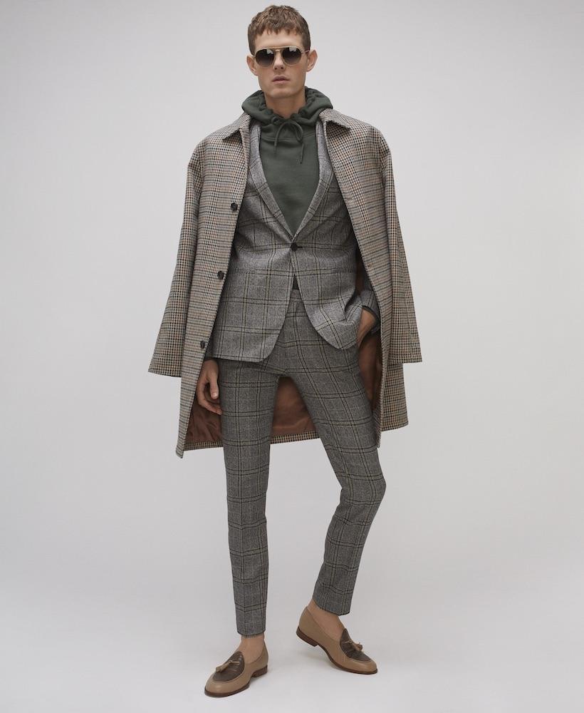 Coat ($140), blazer ($280), and trousers ($120) TOPMAN. Hoodie ($895) VETEMENTS. Sunglasses ($180) FRAMD STUDIO. Shoes ($735) ANGELA MITCHELL.
