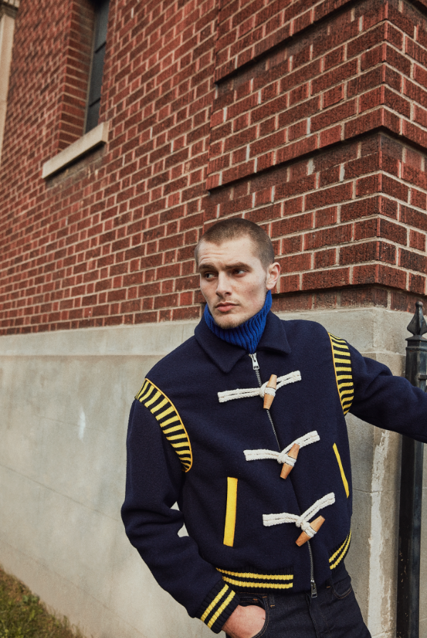 Jacket ($1,995) JW ANDERSON at HUDSON'S BAY. Turtleneck ($160) and Jeans ($180) G-STAR RAW.