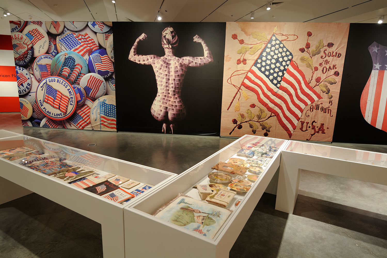Ten-foot-tall blow-up photographs of pieces in the collection serve as a counterpoint to the actual artifacts in the vitrines.