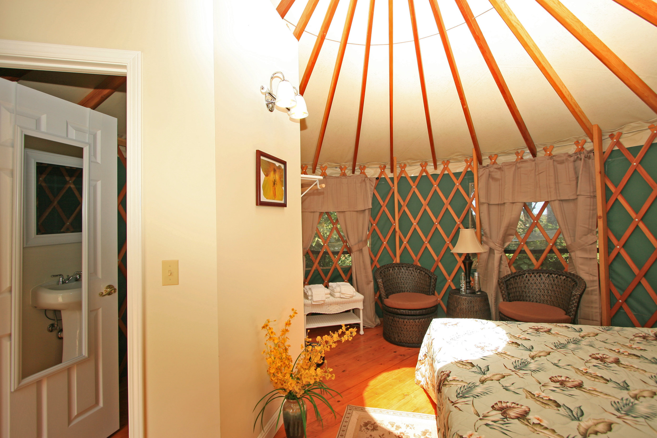 yurt king bed & bathroom.jpg