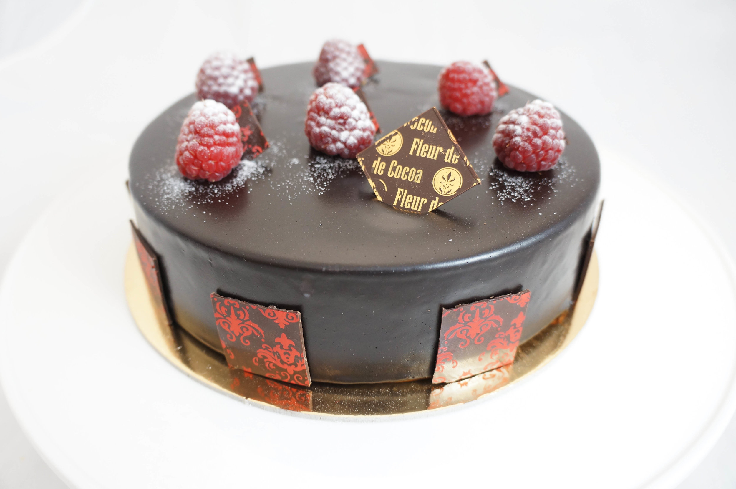 Red and Black   Dark chocolate raspberry mousse with raspberry coulis and chocolate sponge cake. Gluten-free.