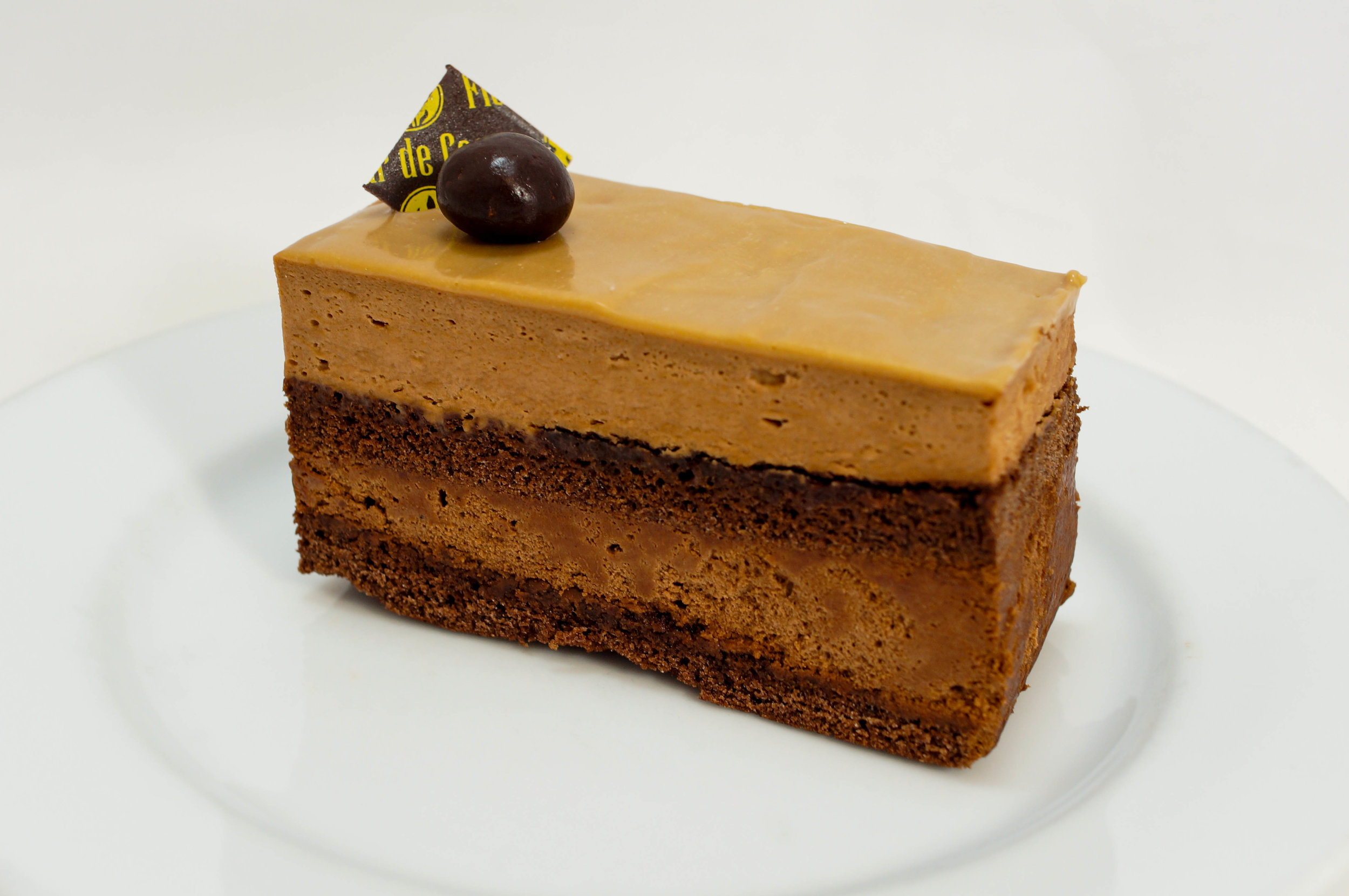 Opera   Coffee butter cream, chocolate ganache, and almond sponge cake (special order). Gluten-free.
