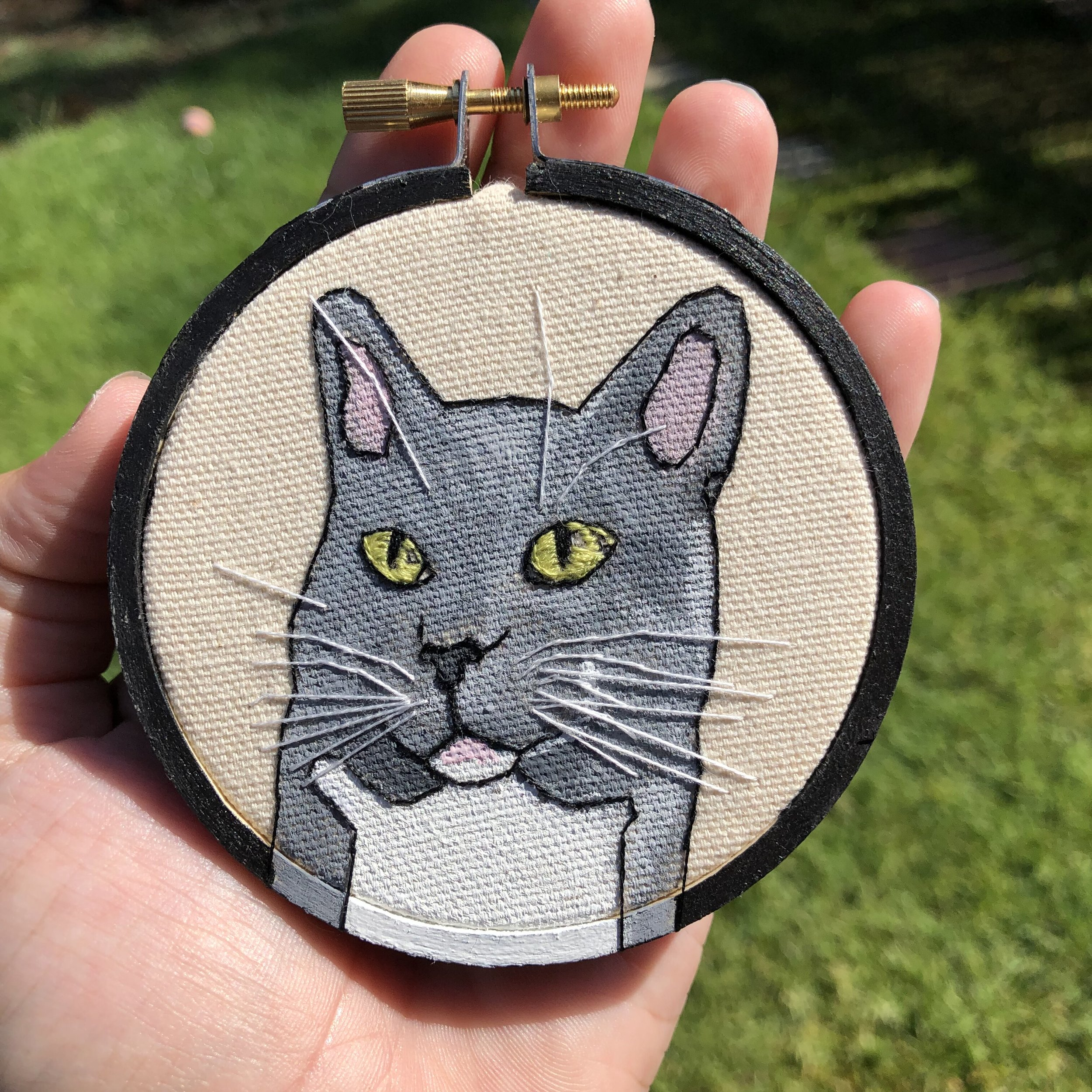 - Working with Taylor was a great experience! I picked what size hoop I wanted, specified the color, and sent some reference photos of our cat, Leonardo. She sent me updates as she worked on the portrait and before I knew it, the completed piece was in my hands! Such a simple process and quick delivery. I am pleased. And Leonardo is too! Thank you!