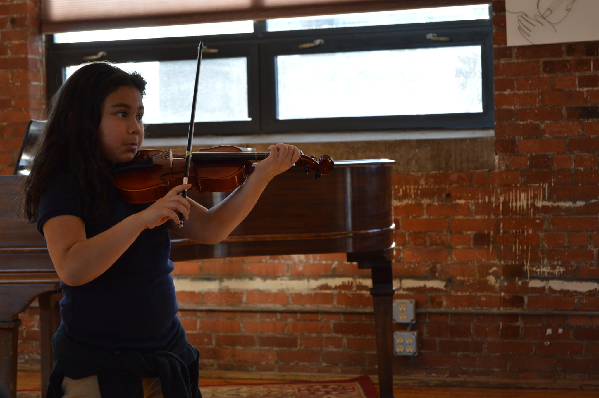 Mei-Lin practicing for her studio recital