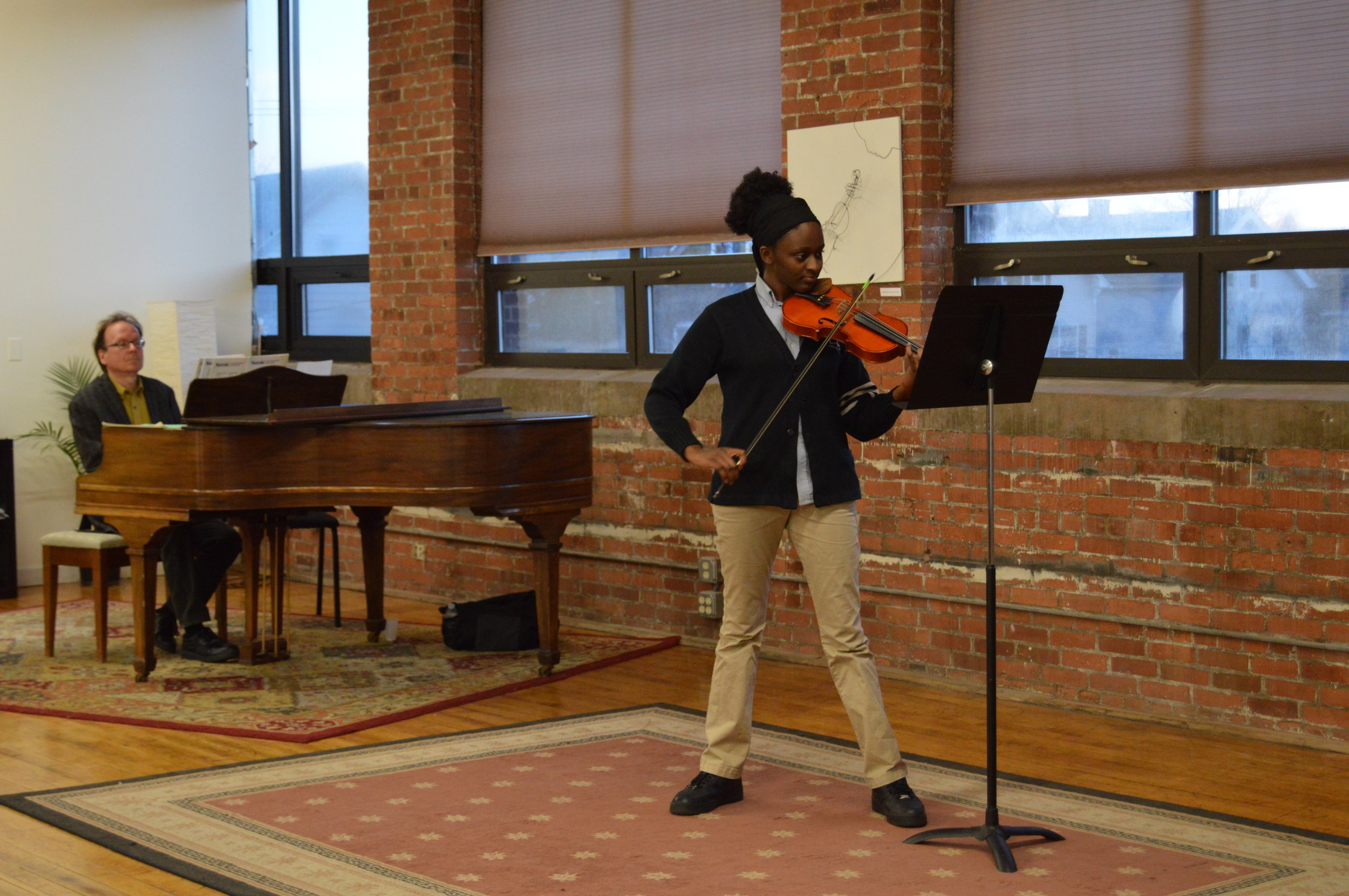 Giovana playing at her 2018 Studio Recital