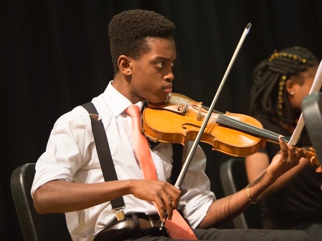 Damani playing at the Spring Performance Party 2018