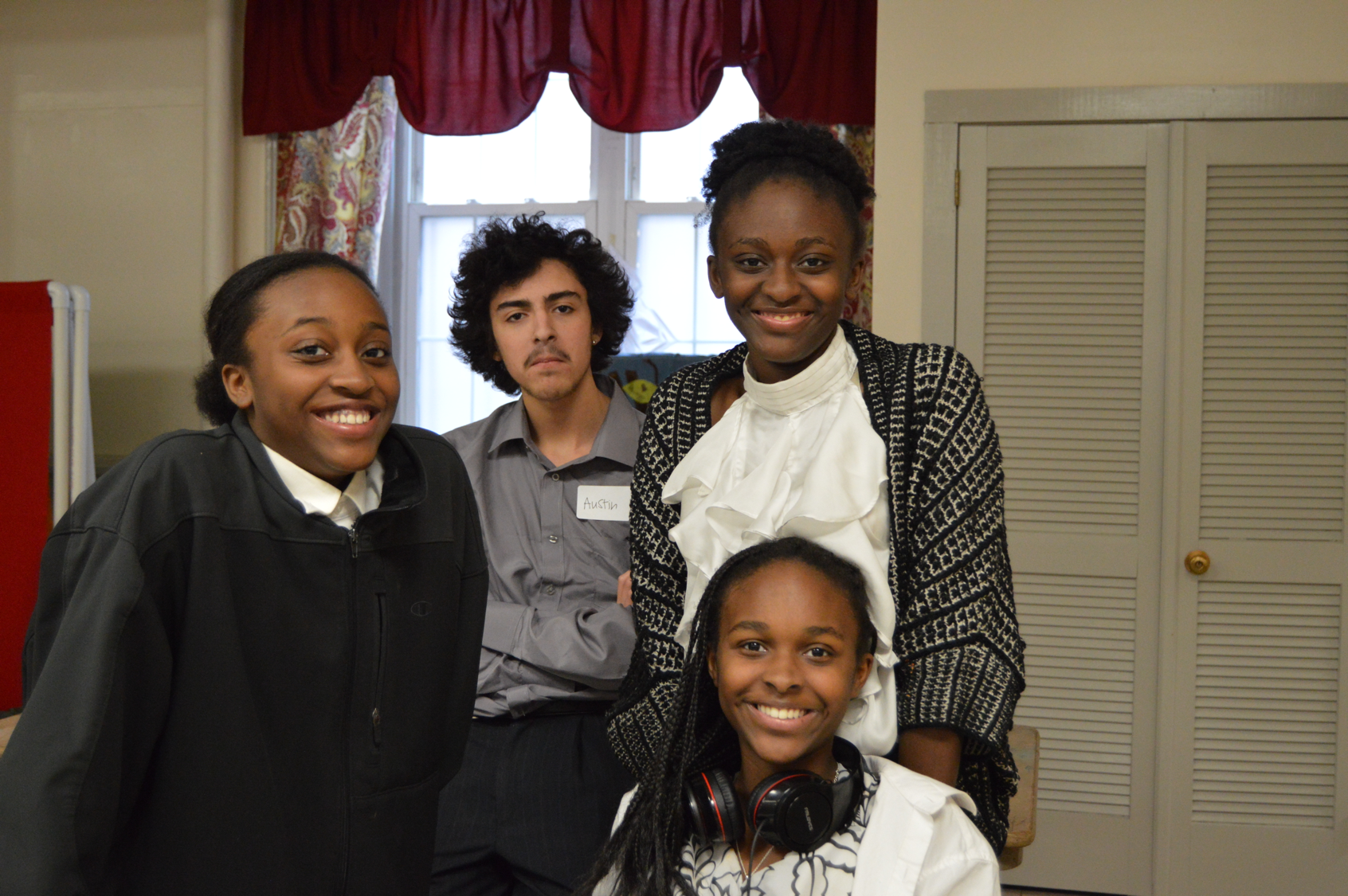 Giovana and her sisters, Giavaya and Giovonda, with their friend Austin at the 2018 MLK Concert