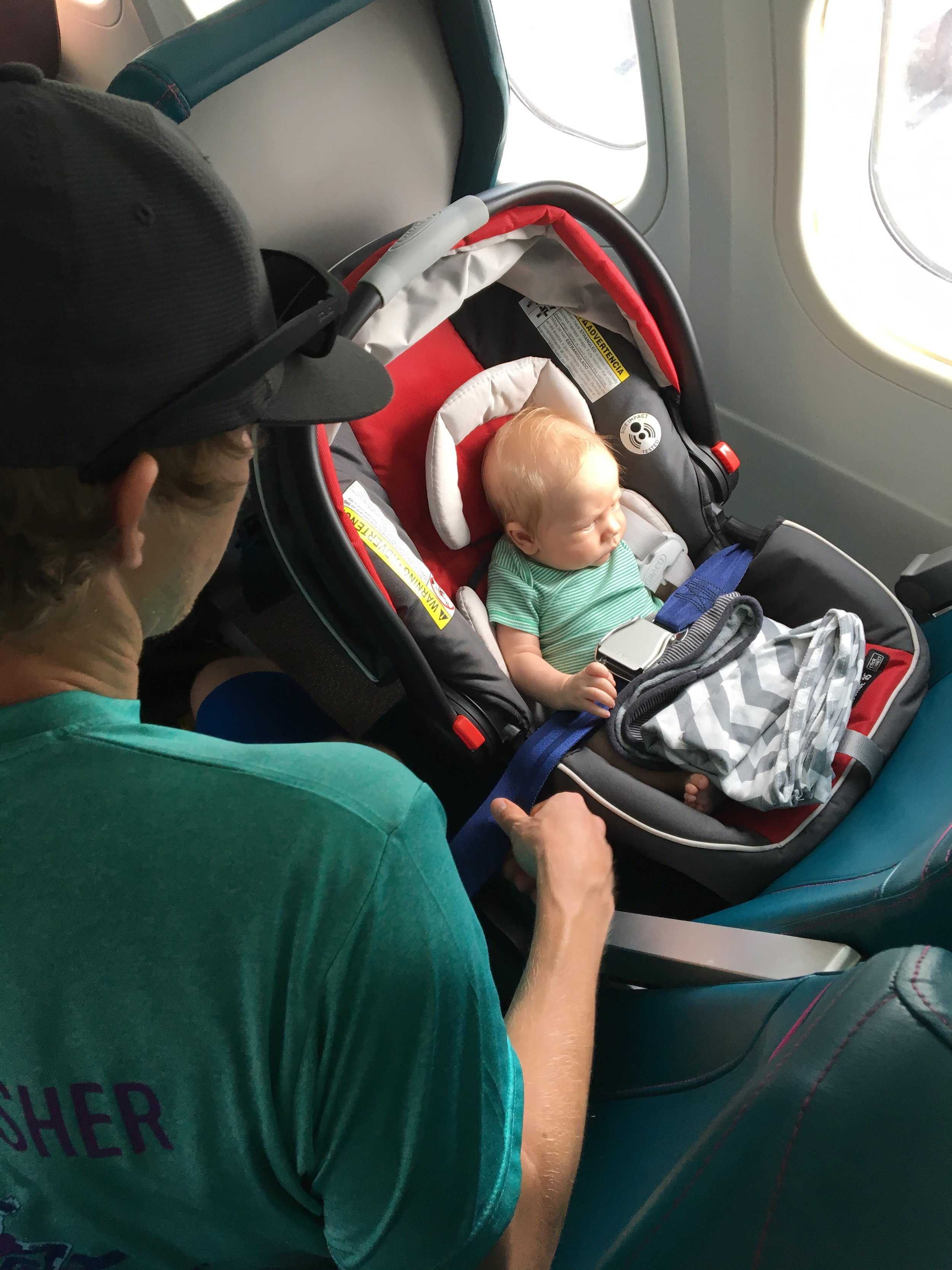 Our son's first flight to the Big Island! What a travel champ!