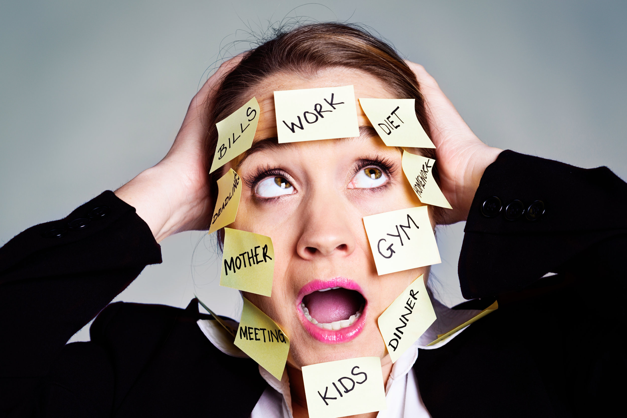 panic-as-businesswoman-is-overwhelmed-by-task-reminder-labels-186581571_5760x3840.jpeg