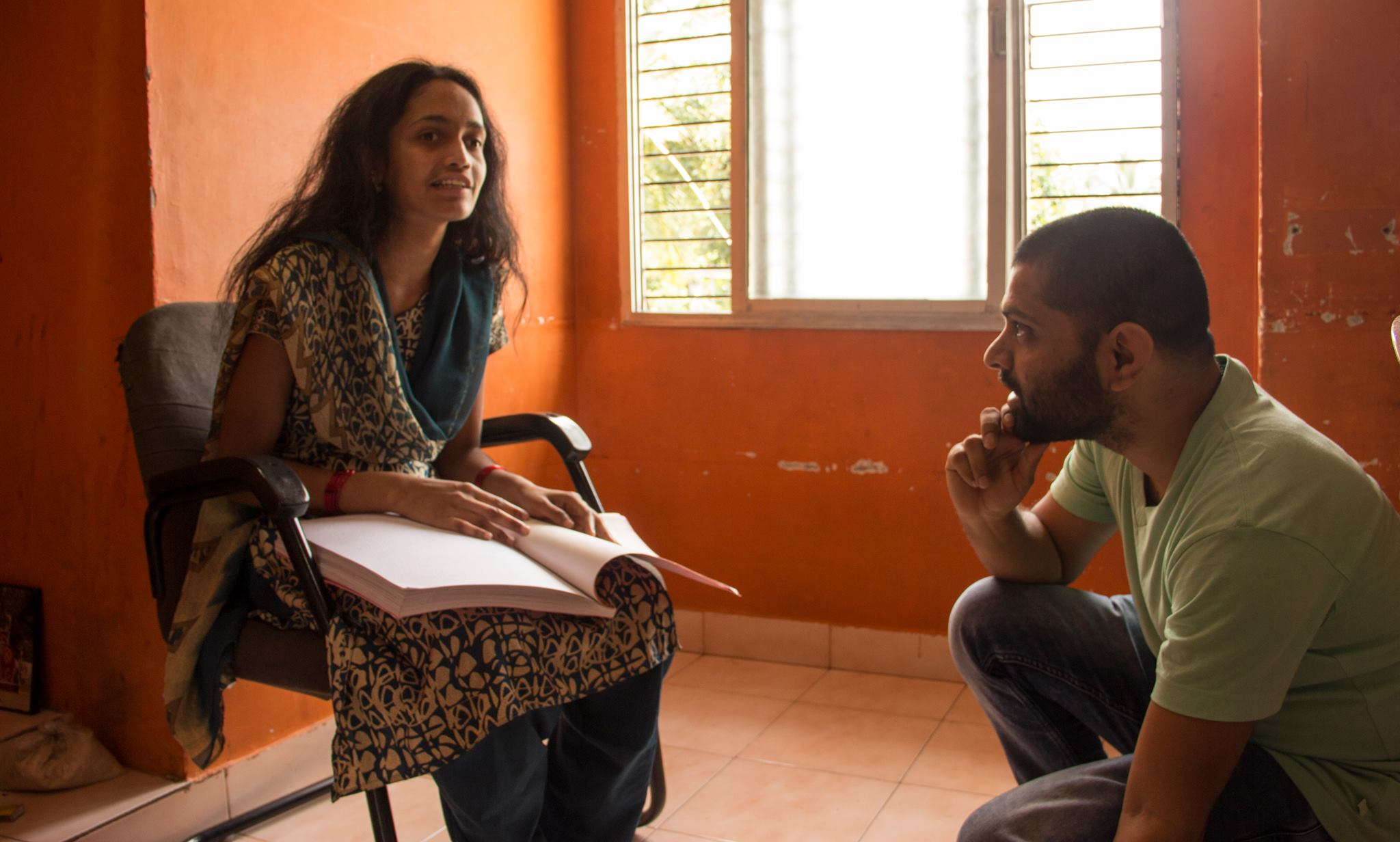 A bright student describing Braille to Rakesh