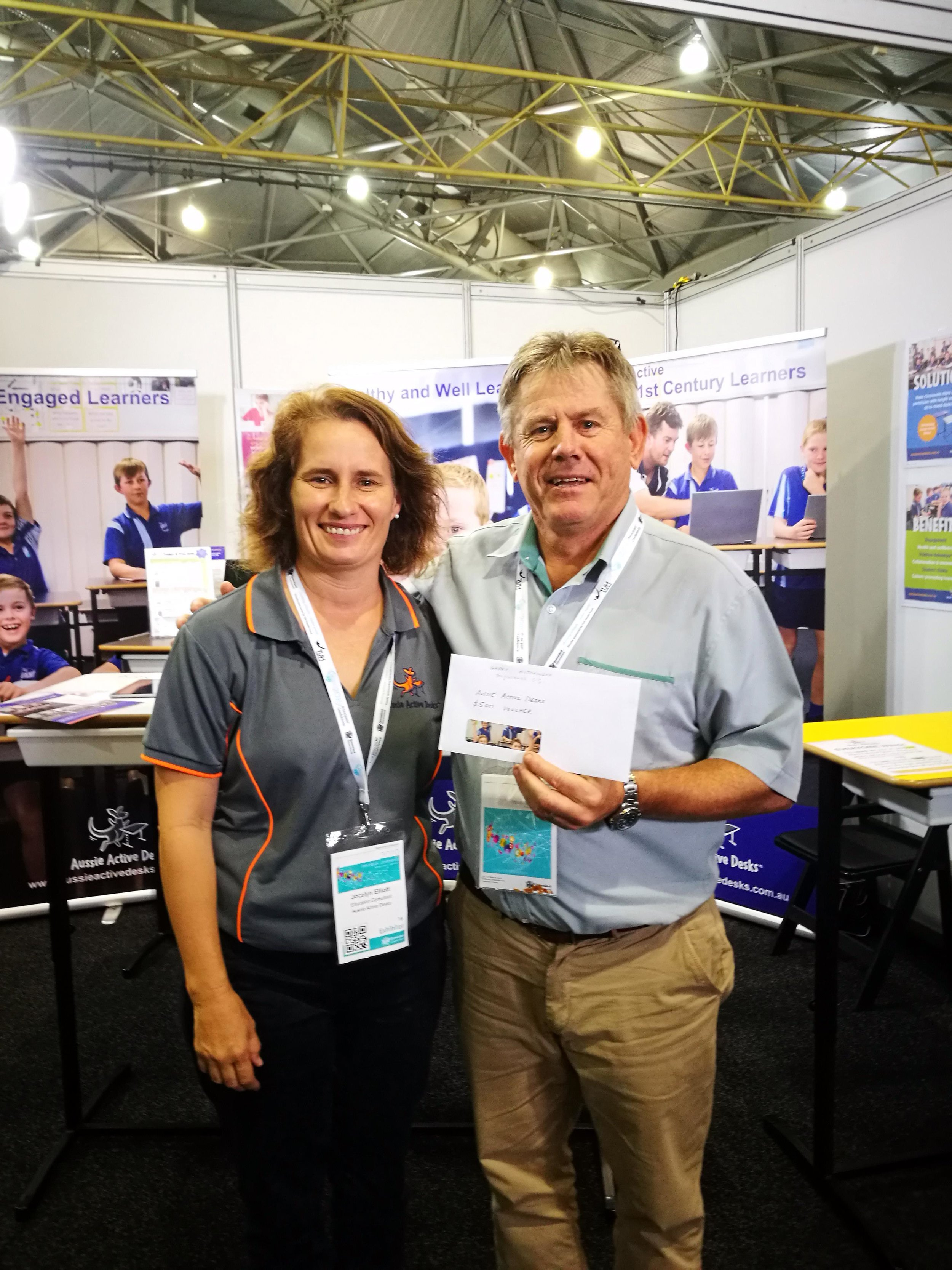 Principal Garry Hutchinson (right) from Toogoolawah State School (pictured with AAD team member) won a $500 AAD gift voucher at the 2019 Principals' Conference.