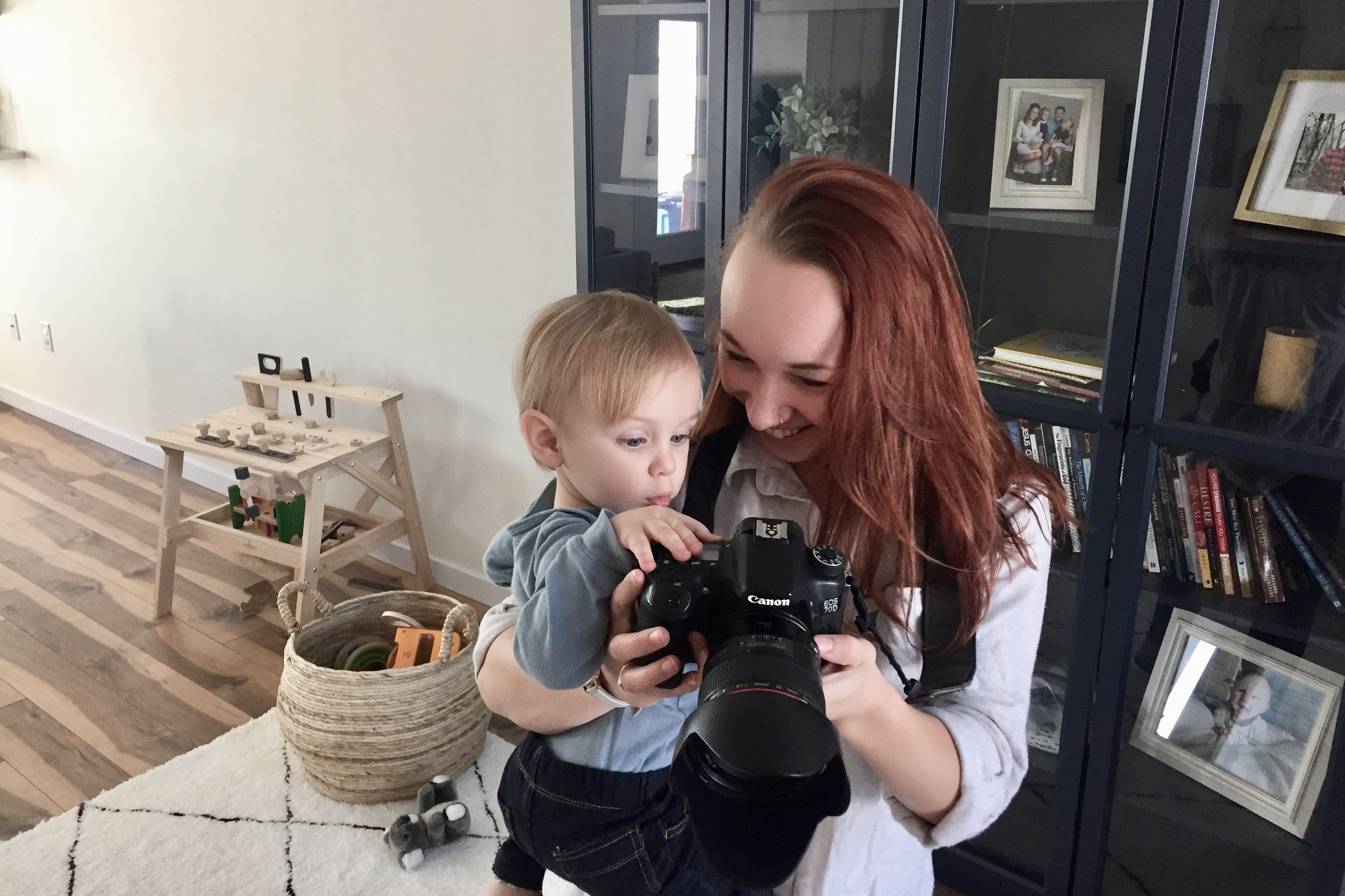 BONUS: a photo of Elijah and I taking photos of mom and dad (if he wasn't captivated by all the buttons, he would have been intrigued by something else)