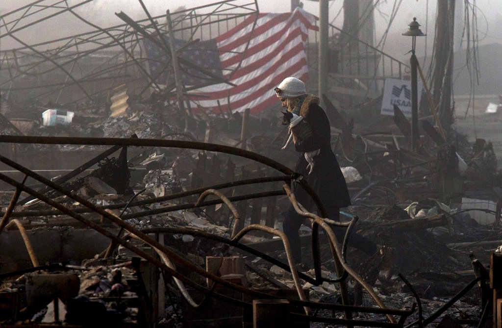 Cold, Dark and Damp, Pockets of Misery Persist 2 Weeks Later    New York Times
