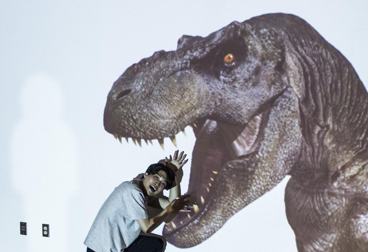 T Rex Eating Justin.jpg