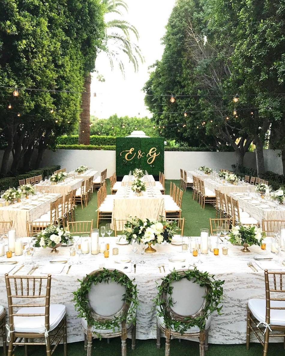 """Custom hedges, parlor and chiavari chairs and a fun linen - everything we love in a photo!"" - Signature Party Rentals"