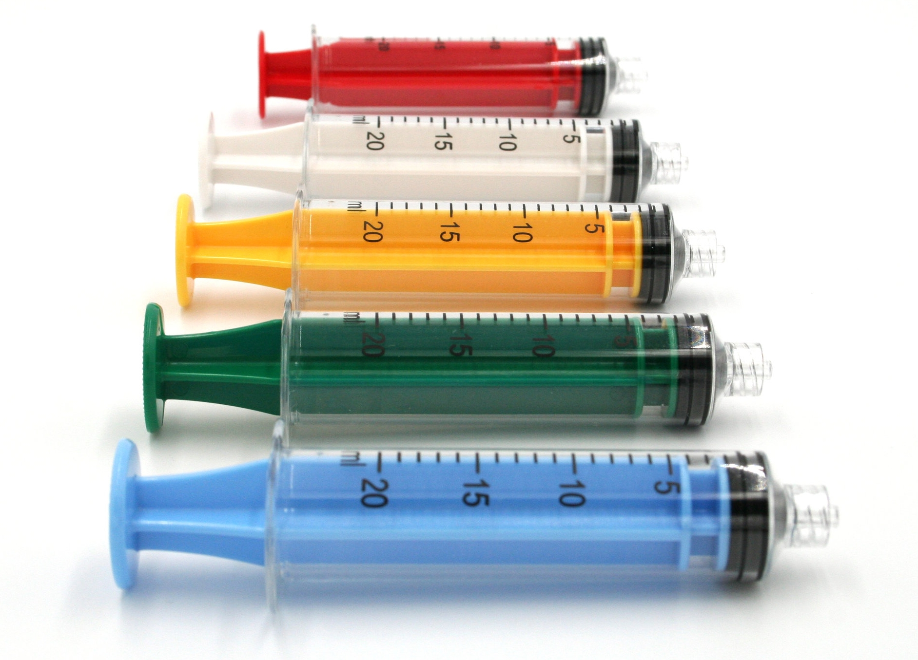 20cc polycarbonate syringes shown above in blue, green, yellow, white, and red