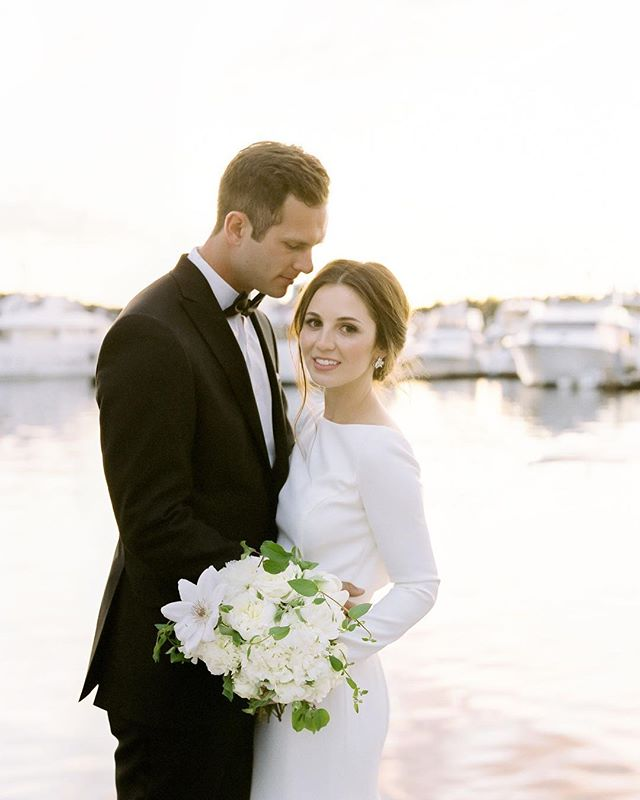 Harborside sunset portraits. Published on @stylemepretty. ⠀ ⠀ Event Planning + Floral Design: @kalebnormanjames | Wedding Dress: @rosaclarabridal | Hair + Makeup: @erinskipley | Venue: @rocheharborwed⠀ ⠀