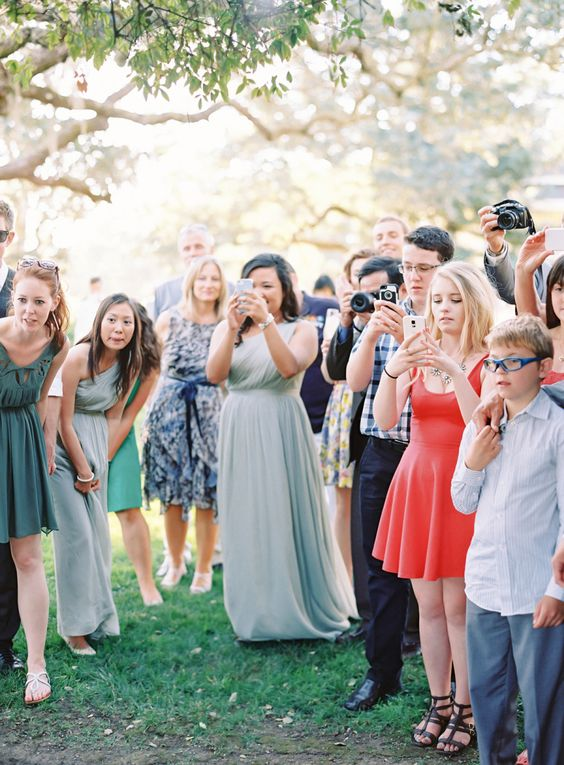 If photos are allowed, PLEASE make sure you ask before posting pictures of the couple online! Photo: Style Me Pretty