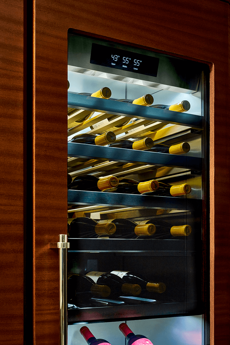 """The 24"""" wide integrated wine column holds up to 113 bottles and can accommodate up to three different temperature zones for reds, whites and sparkling wines."""